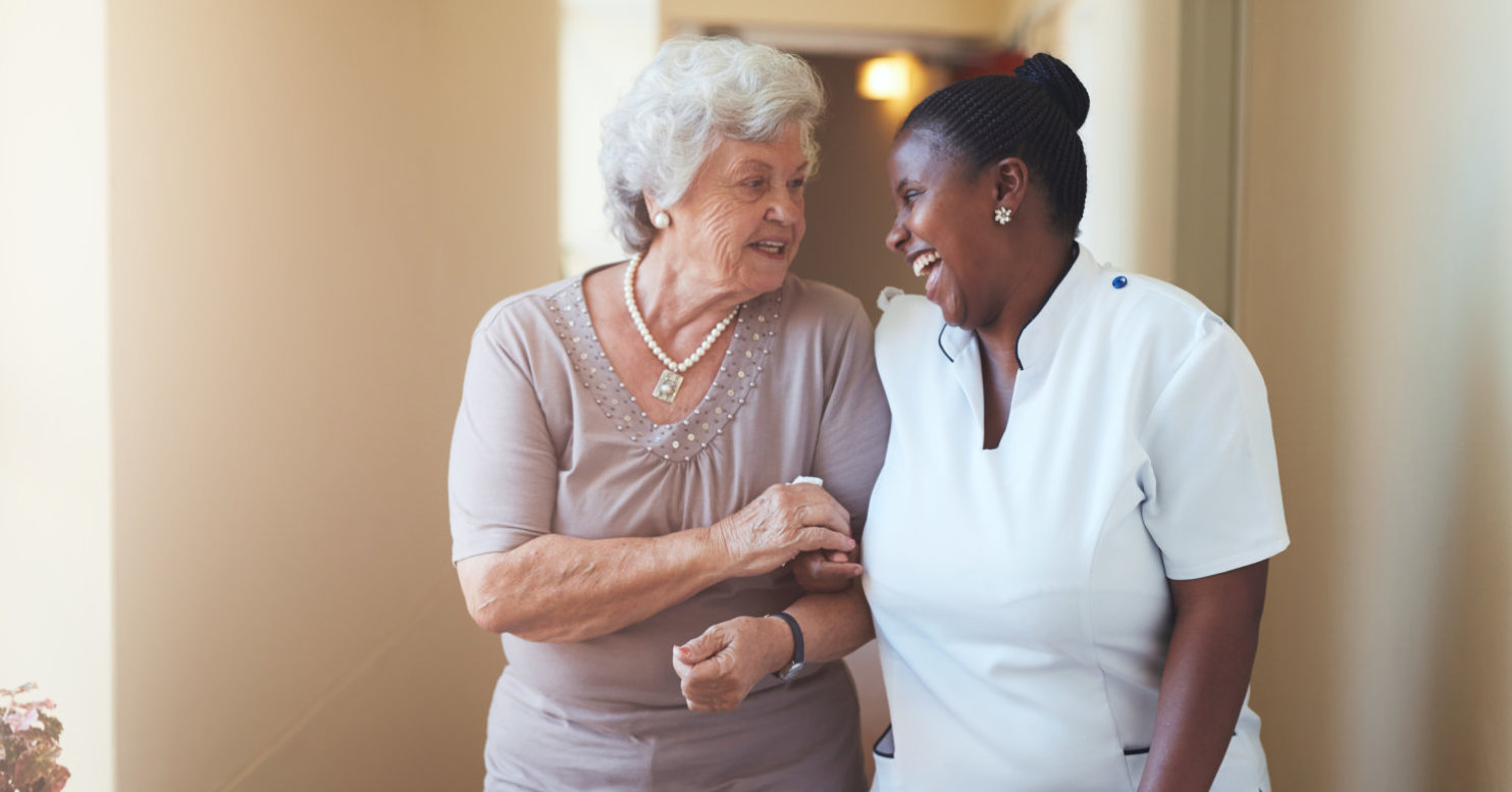 elderly woman and caregiver looking each other