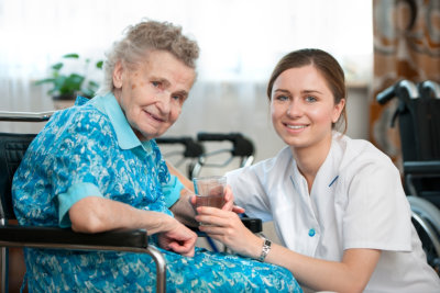 caregiver and senior woman in a wheelchair