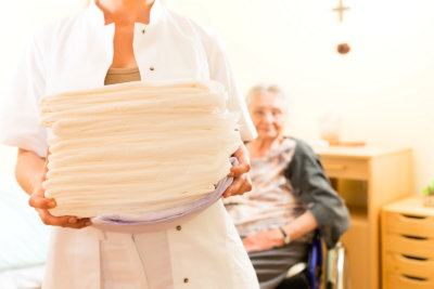 caregiver carrying clothes